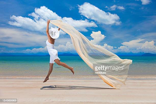 happy woman on the beach - shawl stock photos and pictures