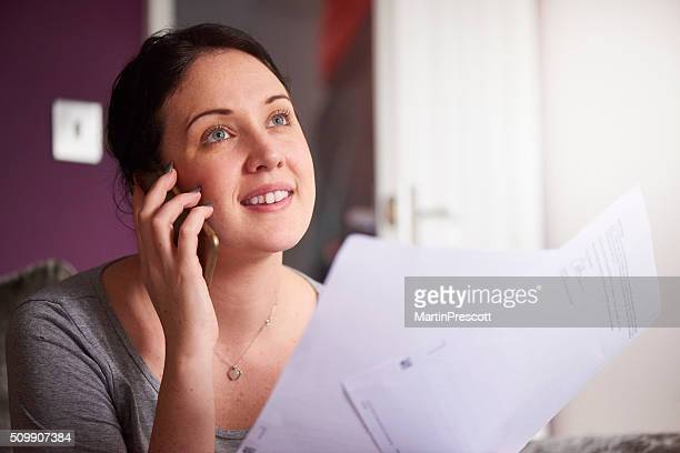 happy woman on the phone with her mortgage company