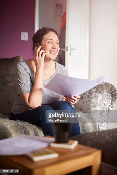 happy woman on the phone with the finance company