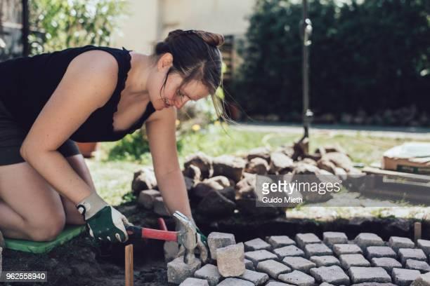 Happy woman paving stone ring.