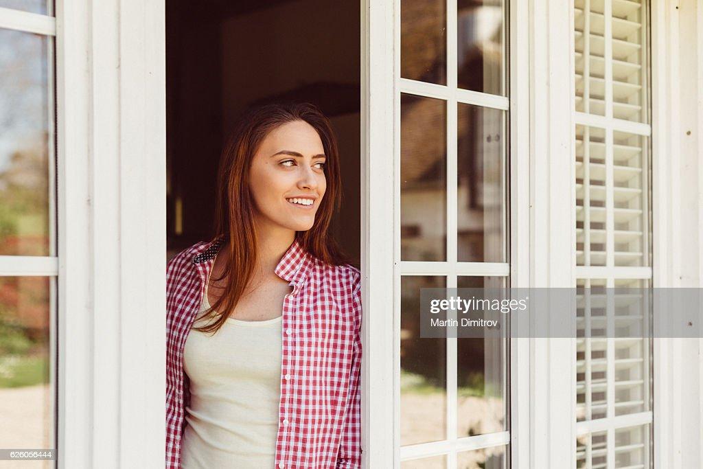 Happy woman peeking out : Stock Photo