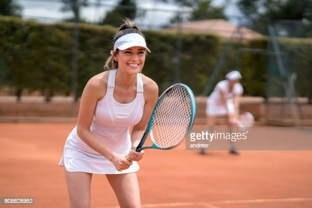 happy woman playing tennis - doubles sports competition format stock pictures, royalty-free photos & images