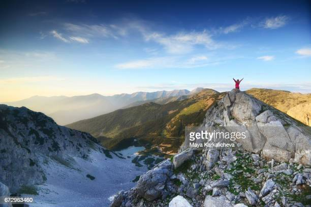happy woman raising her arms up in a beautiful mountain - bansko stock pictures, royalty-free photos & images
