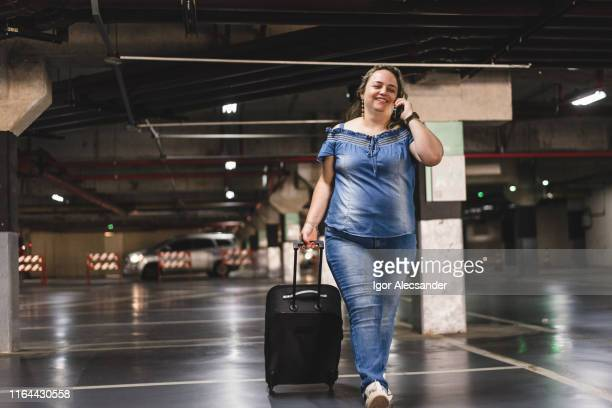 happy woman ready to travel talking on the phone - big fat white women stock pictures, royalty-free photos & images