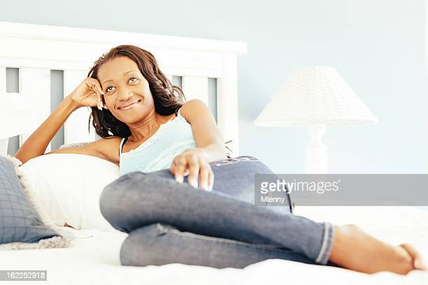 happy woman relaxing on bed,positive thinking - mlenny stock pictures, royalty-free photos & images
