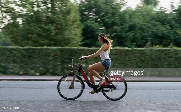 Happy woman riding a bike