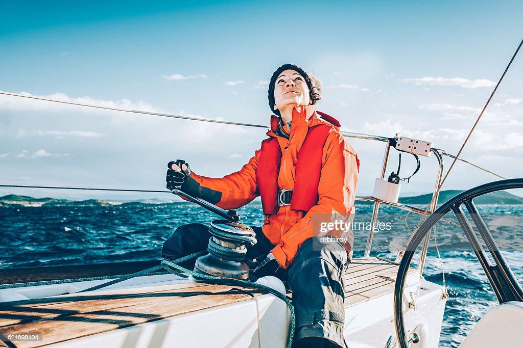 Happy woman sailing during regatta : Stock Photo