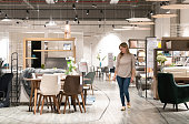 Happy woman shopping at a furniture store