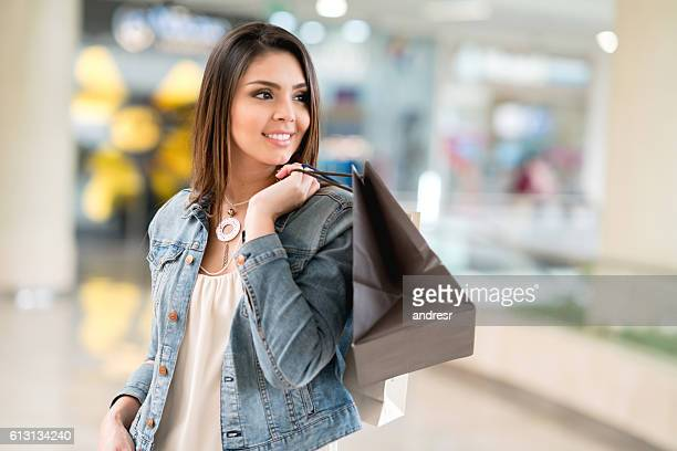 Happy woman shopping at the mall