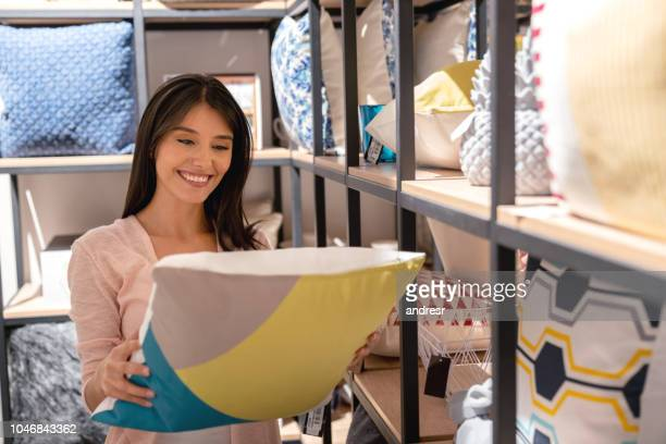 happy woman shopping for her house at a furniture store - bedding stock pictures, royalty-free photos & images