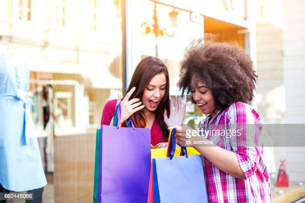 Happy woman shopping in the city