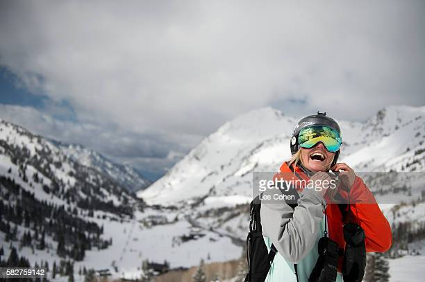 happy woman skier buckling helmet strap - skiing stock pictures, royalty-free photos & images