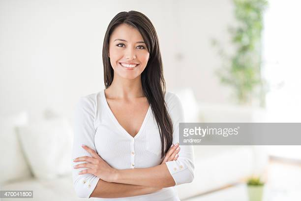 Happy woman smiling at home