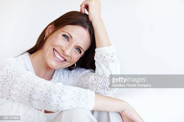 happy woman spending time at home - pretty older women stock pictures, royalty-free photos & images