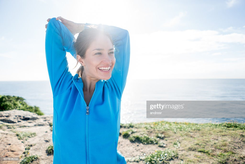 Happy woman stretching : Stock Photo
