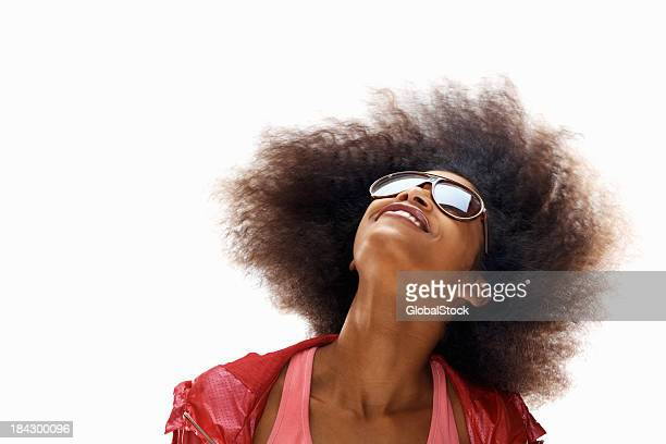 Happy woman swaying her hair on white background