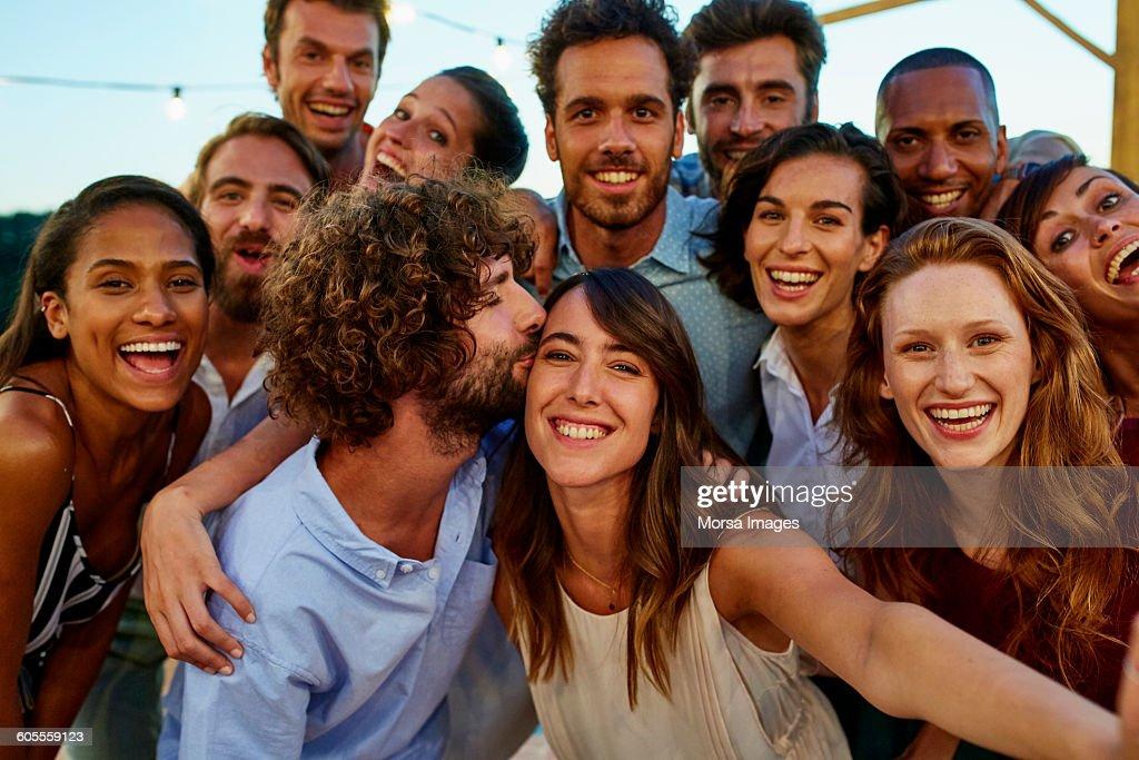 Happy woman taking selfie with friends : Foto de stock