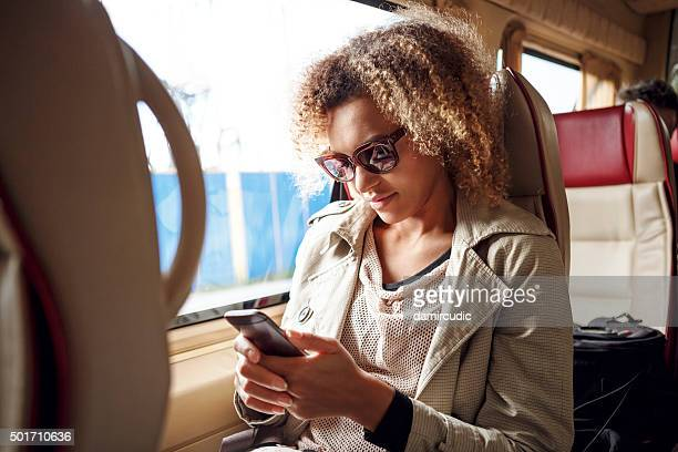 Happy woman texting on her mobile phone