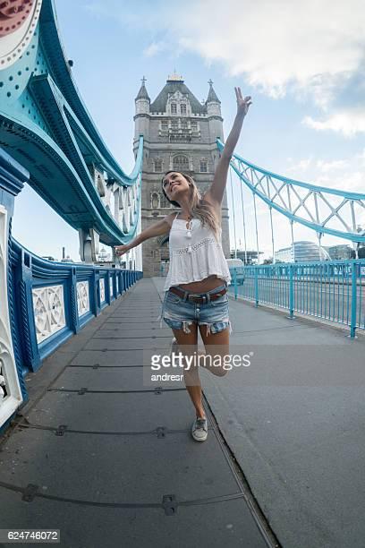 Happy woman traveling in London
