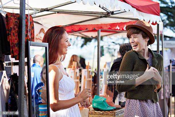 happy woman trying vintage jacket at market - jacket stock pictures, royalty-free photos & images