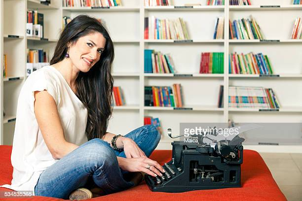 Happy woman typing
