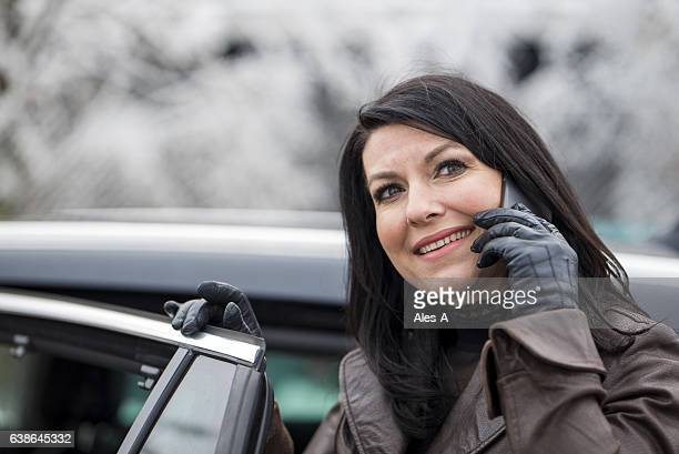 happy woman using smartphone - leather glove stock pictures, royalty-free photos & images