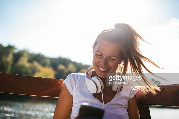 Happy woman using smartphone.