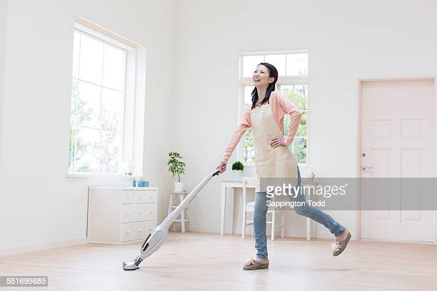 Happy Woman Vacuuming