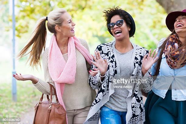 Happy woman walking through park