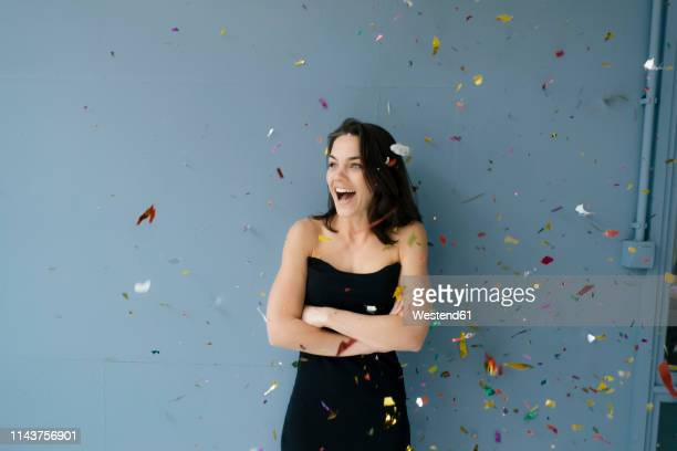 happy woman watching flying confetti - off shoulder stock pictures, royalty-free photos & images