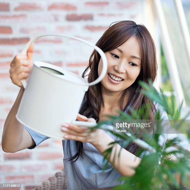 happy woman Watering plant