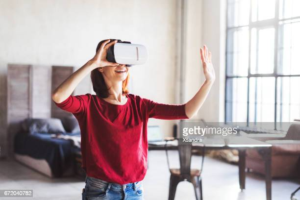 happy woman wearing vr glasses headset - wonder 2017 film stock pictures, royalty-free photos & images
