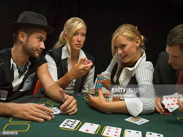 Happy woman winning at poker game