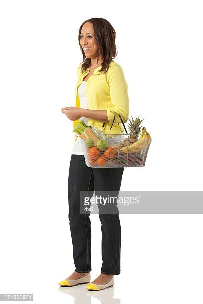Happy woman with a basket of fruits