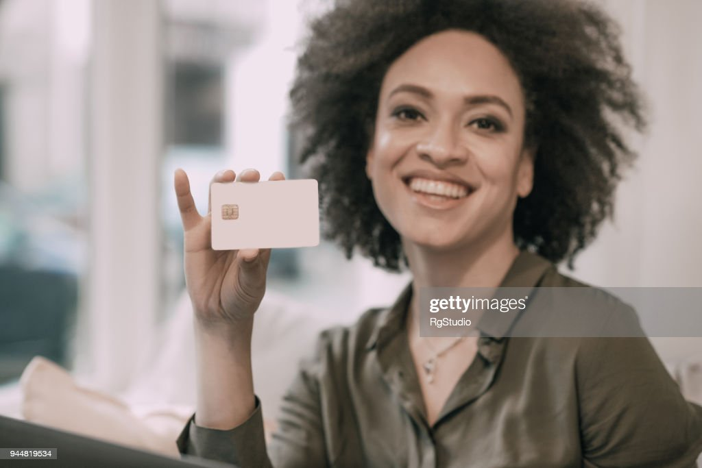 Happy woman with a credit card : Stock Photo