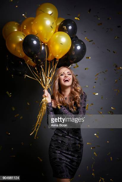 Happy woman with balloons celebrating her birthday. Debica, Poland