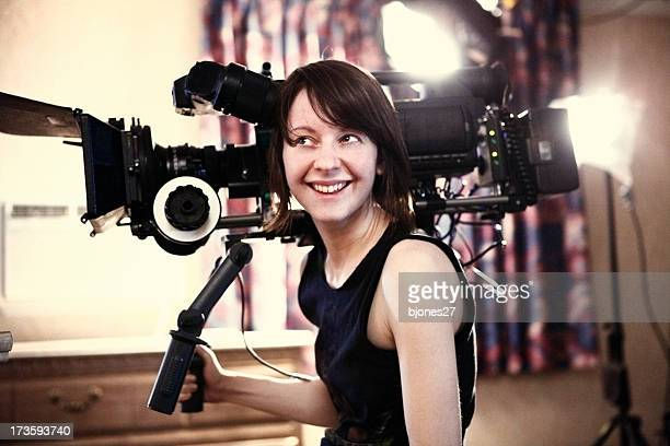 happy woman with camera - film crew stock photos and pictures