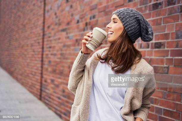 happy woman with coffee to go - one young woman only stock pictures, royalty-free photos & images