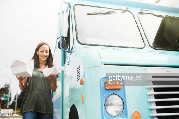 Happy Woman With Food Truck Meal