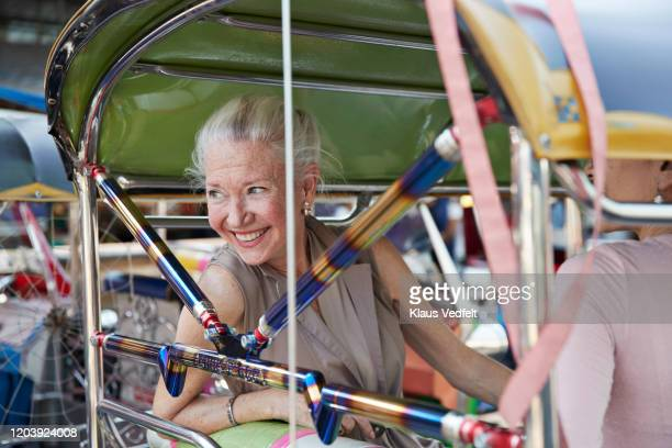 happy woman with friend sitting in tuk-tuk ride - auto rickshaw stock pictures, royalty-free photos & images