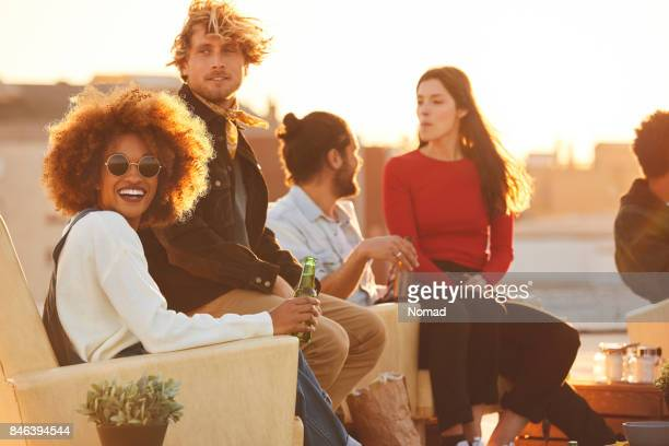 Happy woman with friends during rooftop party