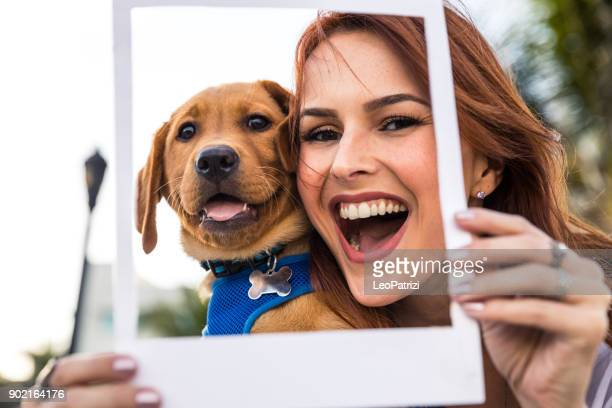 happy woman with his labrador puppy in miami beach. - day stock pictures, royalty-free photos & images