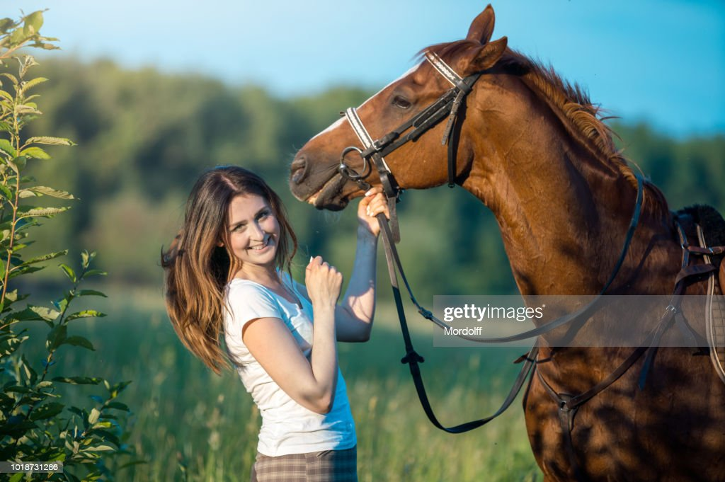 Happy Woman with Horse Outdoors : Stock Photo