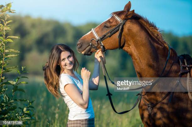 happy woman with horse outdoors - dressage horse russia stock photos and pictures
