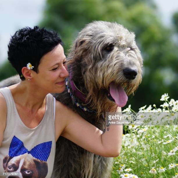 Happy Woman With Irish Wolfhound At Park