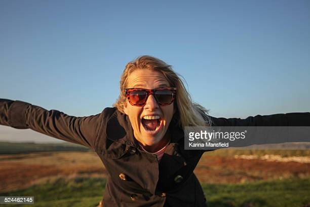 Happy woman with open arms
