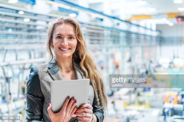 happy woman with tablet in plastic factory - beautiful czech women stock photos and pictures