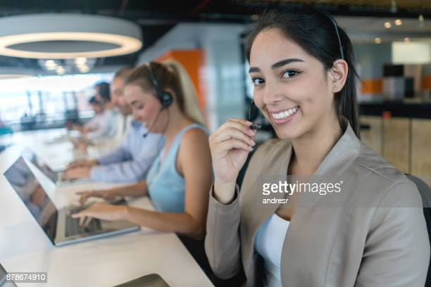 Happy woman working at a call center