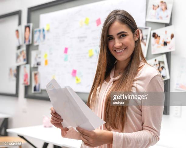 Happy woman working at a creative office