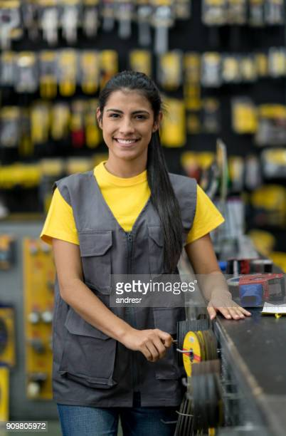 Happy woman working at a hardware store